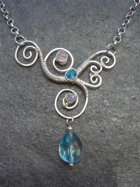 how to make wire jewelry pendants asymmetrical wire wrapped pendant by chloelb on deviantart