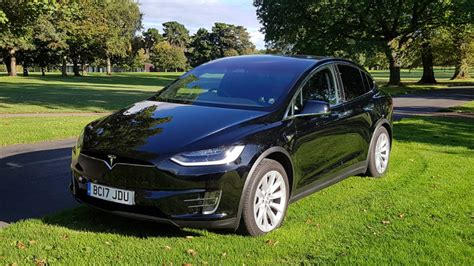 Wedding Car Wales by Black Tesla Model X Available To Hire For Weddings In