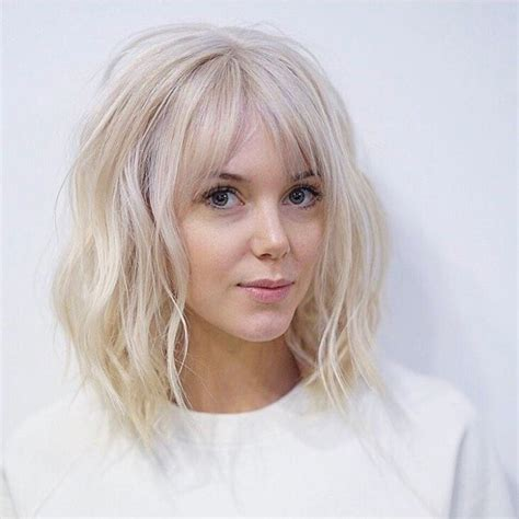 short wedge haircuts with middle part women s long platinum bob with wavy fringe and parted bangs