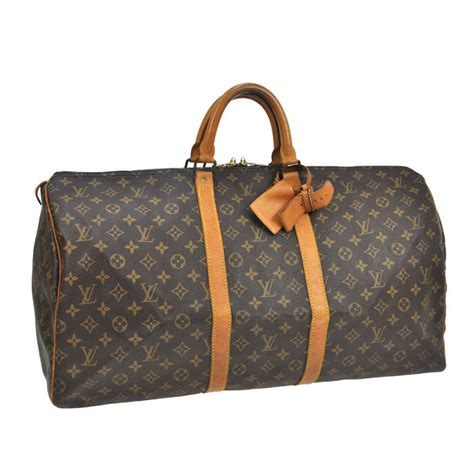 louis vuitton trash bag finest travel with keepall louis vuitton i am a traveler with louis louis vuitton keepall 55 monogram travel bag with name