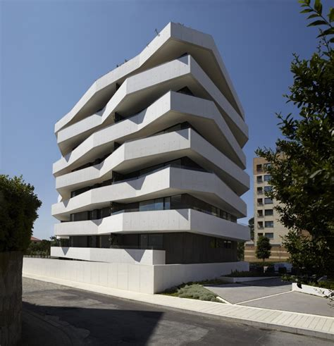 Building Geometric Shape geometric apartment building by demm arquitectura home building and