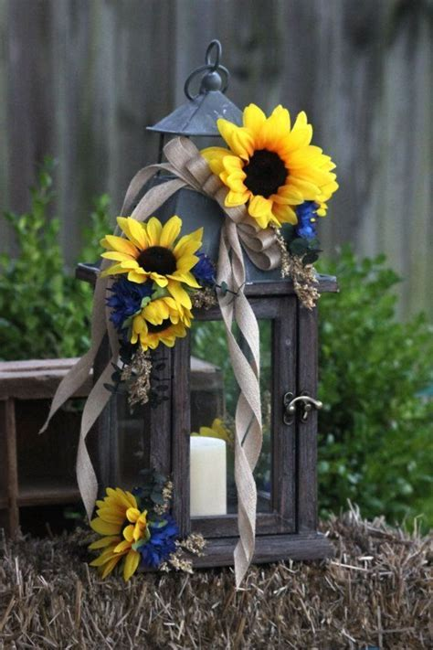 Yellow sunflowers and Navy blue centerpieces   Can't get