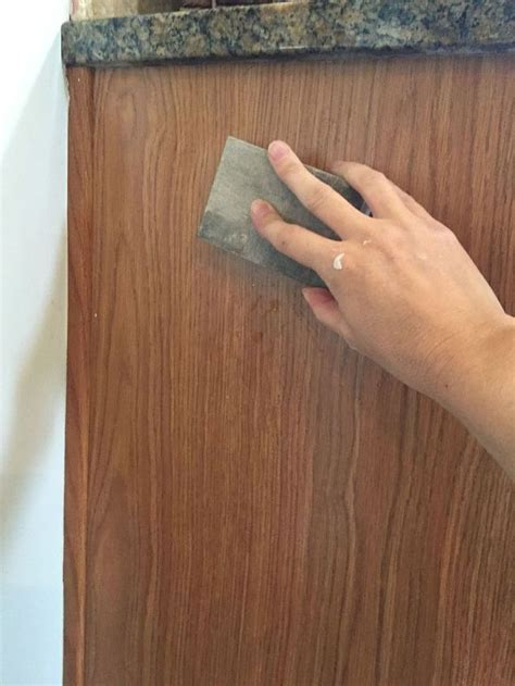 painting already painted cabinets diy painted kitchen cabinets hometalk
