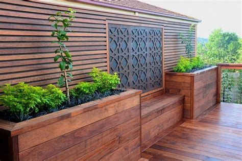 Planter Screen by Merbau Decking With A Custom Made Screen Planters And Built In Seating Melbourne Decking