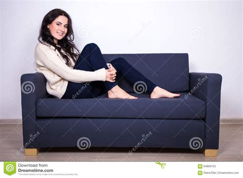 couch girl pretty girl sitting on sofa at home stock photo image