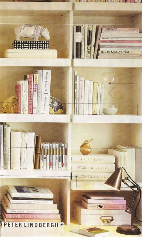 bookcase decor simply arranging similar color books in