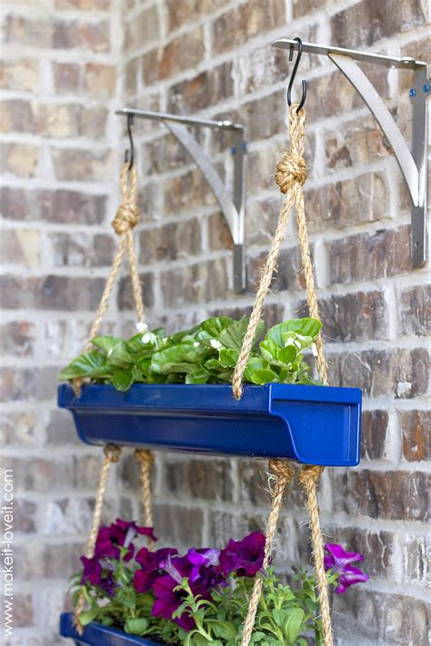 how to make hanging planters diy hanging rain gutter planters make it and love it
