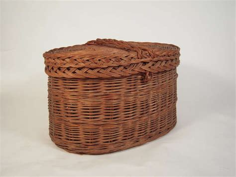 decorative covered baskets very large oval covered rattan basket at 1stdibs