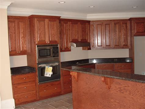 kitchen color schemes with wood cabinets wood cabinet colors kitchencalm kitchen color ideas with