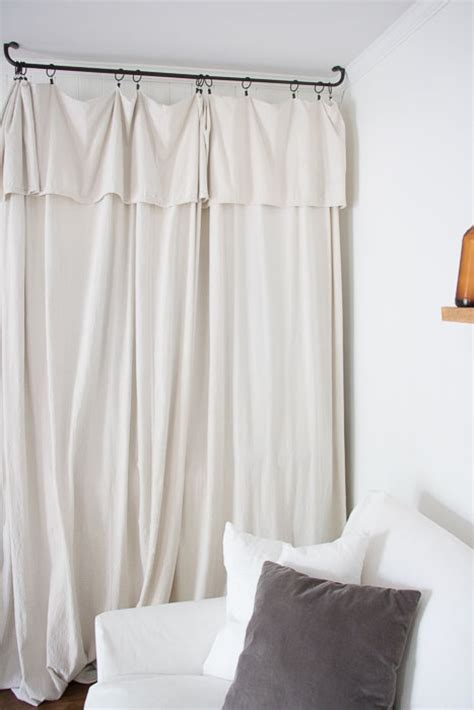 tv curtains how to hide a tv with a drop cloth curtain seeking