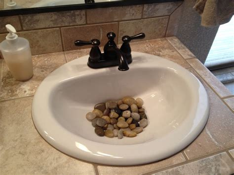 where to buy rocks for sink 25 best ideas about river rock bathroom on