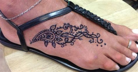 henna looking tattoos traditional looking tear drop and swirls on foot freehand