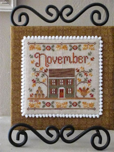 country cottage needleworks cottage of the month october cross stitch pattern 123stitch com country cottage needleworks showcase and stitch a long