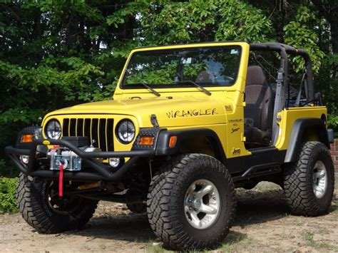 yellow jeep blacked out grill and headlight rings for the jeeps