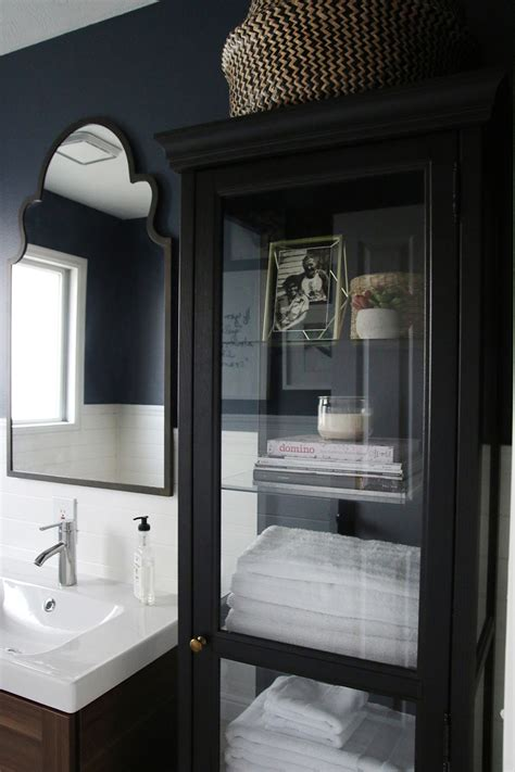 done in a weekend bathroom refreshes vanities cabinets and striped walls a half bath refresh chris loves julia