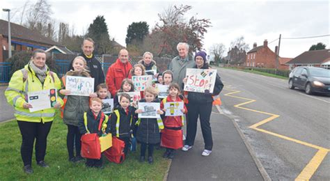 stop 28 farm and nursery nursery children hold up signs asking drivers to let them cross the road newark advertiser