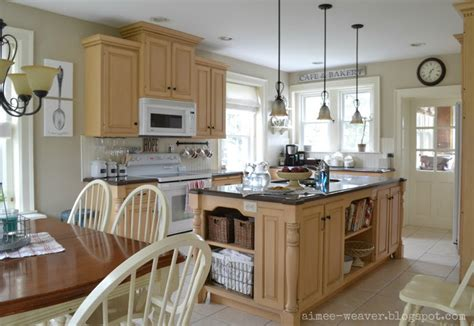light kitchen with maple cabinets for the home
