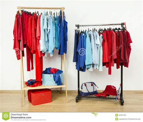Nicely Duo Dress X S M L wardrobe with and blue clothes hanging on a rack