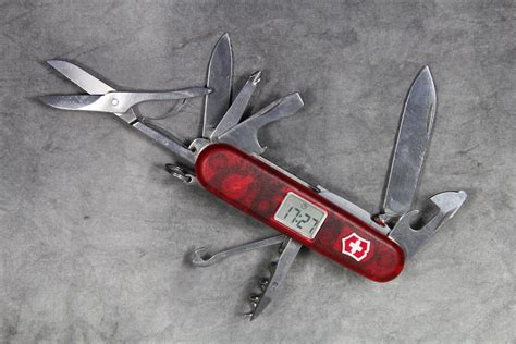 swiss army knife with light victorinox swiss army voyager lite pocket knife with clock