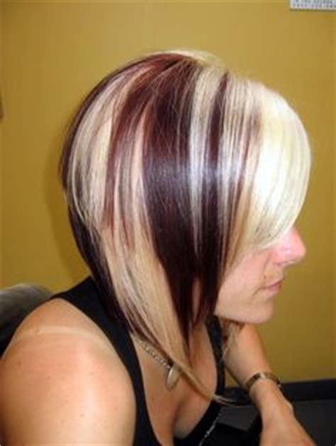 brunette to platinum streaks chunky highlights platinum vibrant red violet angled bob
