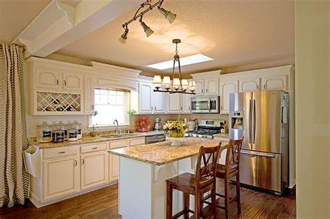 Santa Cecilia Light Granite With White Cabinets by Discover And Save Creative Ideas