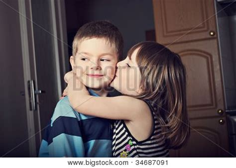 boy kissing a girl in bedroom picture or photo of adorable little girl kissing a boy in the room