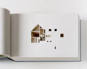 your home the negative space of a house cut inside a 908 page book
