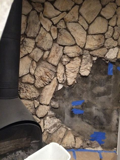 removal of 1970s faux rock lava wall fireplace