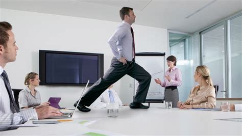 Desk Exercises At The Office 10 Easy Exercises You Can Do At The Office The America S Finest News Source