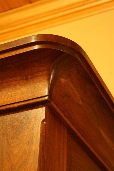 Solid walnut armoire crown molding detail