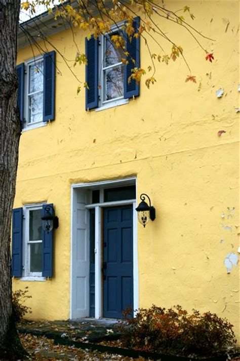 yellow house with blue door yellow house blue door white trim and shutters because