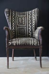 mud cloth covered chair with black and white tribal