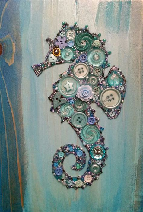 Button Painting button seahorse on recycled wood with acrylic paint background button seahorse