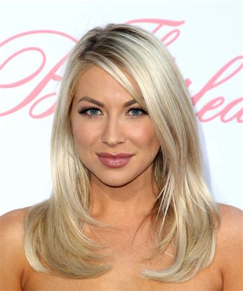 front view of side swept hairstyles stassi schroeder medium straight casual hairstyle with