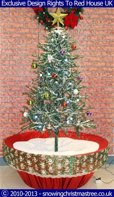 snowing christmas tree artificial snowfall red