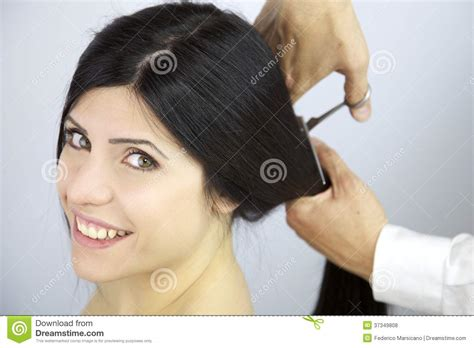 getting a haircut female styled happy to change hairstyle cutting my long hair stock photo