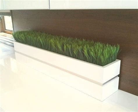 modern white lacquer planter box with grass by