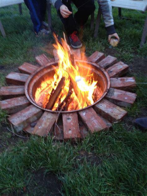 diy fire pit dig  hole burry  tire rim decorate