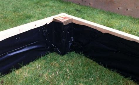 garden bed liner staple plastic sheeting to the inside of raised beds to