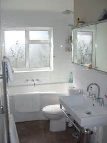 white ceramic bathtub with glass wall partition combined