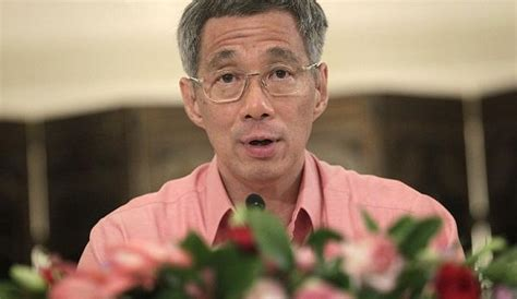 singapore pm lee hsien loong shares grief after death of singapore to review cabinet salaries