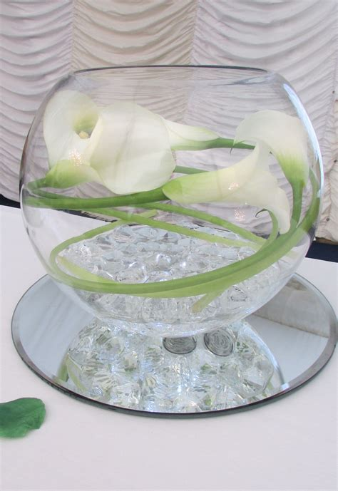 Goldfish bowl with calla lily and lights for wedding table