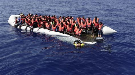 refugee on boat at least four dead in attack on refugee boat near libya