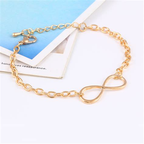 Charm Daun Ukir Ala 011 tripleclicks plating gold metal cross infinite bracelet bangle charm chain bracelets