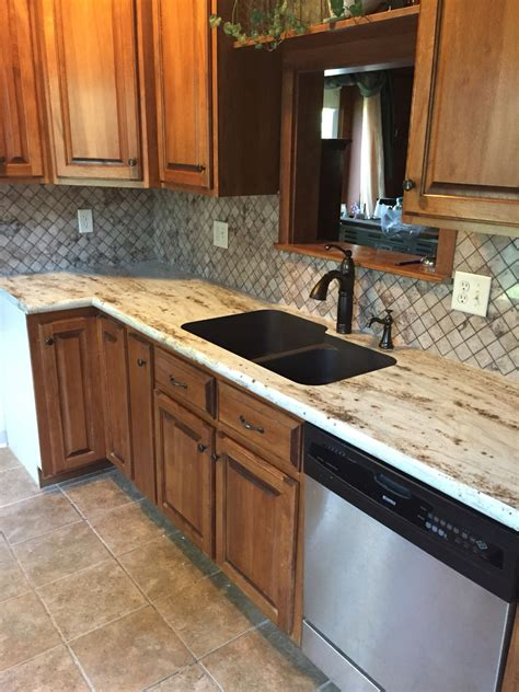river gold formica countertops with tyvarian tile