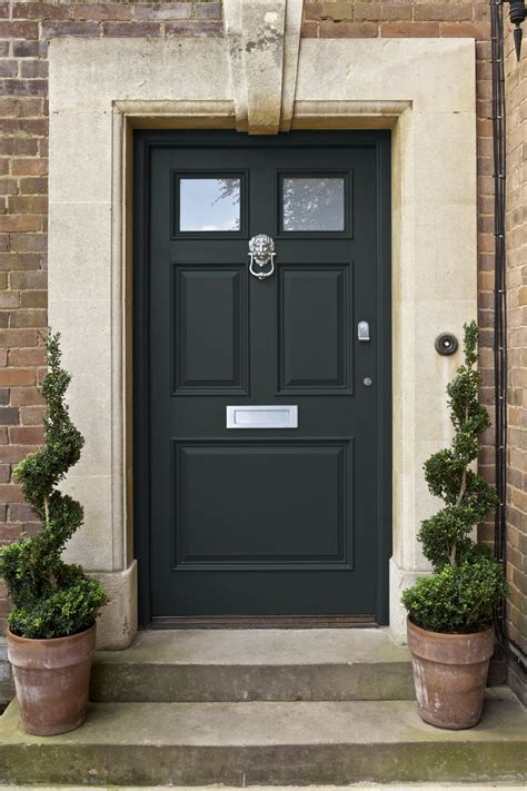 green front door decorating with dark paints