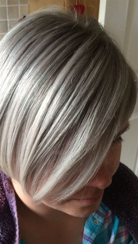Silvery Blonde Highlights | color correction hot pink to a silvery ash modern salon