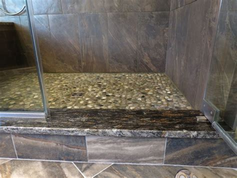 tile baseboard comes up to the granite shower threshold