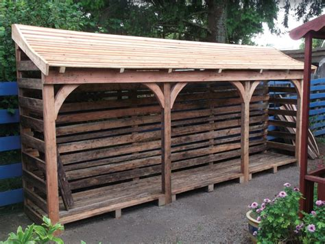 handmade wood shelters  storing logs  firewood