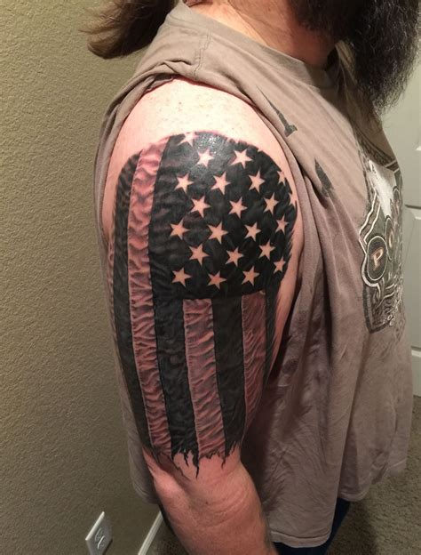 black flag tattoo american flag in photo realism black and white